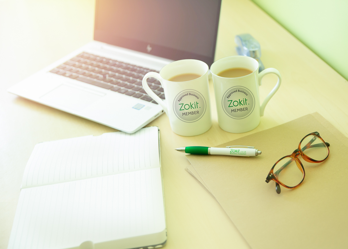 Zokit Marketing Images, Online marketing images, laptop, glasses, zokit pen and mugs, notebook